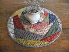 Hey, I found this really awesome Etsy listing at http://www.etsy.com/listing/162251031/round-crazy-quilted-table-topper
