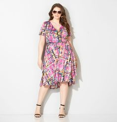 Shop multicolor summer dresses in abstract mini pain stroke prints like our plus size Abstract Check Hi Lo Wrap Dress available in sizes 14-32 online at avenue.com. Avenue Store