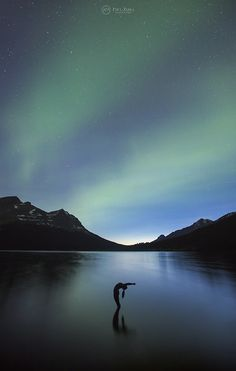 One with the Night - Aurora Yoga at Bow Lake, Banff National Park, Alberta, Canada.