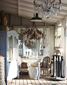 beautiful inspiration  old doors with mirrored paned placed behind side board..mirror placed over sideboard...