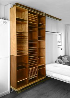 sliding storage hides murphy bed