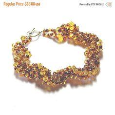 On Sale Light Topaz Swarovski Crystal and Seed Beaded Spiral Bracelet,... ($19) ❤ liked on Polyvore featuring jewelry, bracelets, swarovski crystal jewellery, swarovski crystal jewelry, beaded jewelry, spiral jewelry and bead jewellery