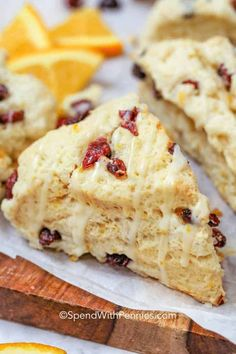 These easy Cranberry Orange Scones can be made with greek yogurt or buttermilk for a moist but crumbly dessert. Drizzle with a simple orange glaze before serving for the perfect citrusy flavor. #spendwithpennies #CranberryOrangeScones #dessert #sconerecipe