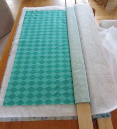 """How to baste a quilt with two 1""""x3"""" boards. No kneeling, can be done on a dining room table. Genius! I soooo needed to know this!"""