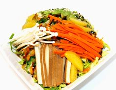 Our Rice Bed #Salad1:   #Romaine, #English #cucumber, baked #tofu, #orange supremes, julienned #carrots & #enoki mushrooms. Served with chili mango, carrot ginger and sweet soy mirin sauce!