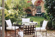 Designer Myra Hoefer created an outdoor dining room as part of a Mediterranean San Francisco home. Landscape designer Elizabeth Everfell did all of the courtyard's formal but romantic paintings.