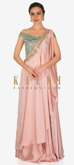 Buy Online from the link below. We ship worldwide (Free Shipping over US$100)  Click Anywhere to Tag Cerulean Blue Top and Rose Pink Satin Lehenga Styled with Zardosi Handwork Only on Kalki This satin lehenga set consists of an off shoulder cerulean blue blouse that's fashioned with floral and foliage motifs covered with zardosi.The rose pink lehenga is draped gracefully at the front and flaunts an embellished border.