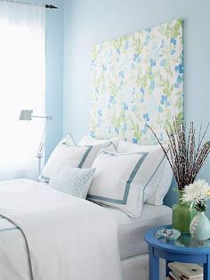 Big Personality Add style to a plain wall with an extra-high patterned upholstered headboard. The blue and green flowers on this print are perfect for the whimsical bedroom and make a statement on the light blue walls. - home me Home Decor Bedroom, Small Spaces, Beautiful Bedrooms, Home, Headboard Decor, Upholstered Headboard, Home Bedroom, Decorating Small Spaces, Home Decor