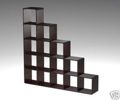 More cubes. Everybody like cubes. But this one at least has an interesting staircase look.      Cube Room Divider - reviews and photos.