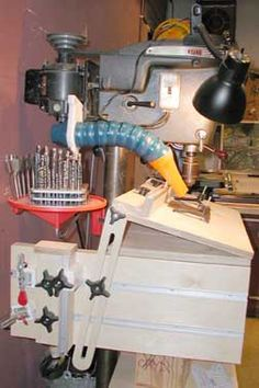This drill press table tilts and has plenty of T-track for vertical and horizontal drilling set ups.