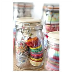 use old candle jars for everything. Buttons, tea lights, change jar, etc. Like the muffin pan liners in there too. They always get squished in the cupboard. Baking Storage, Baking Organization, Jar Storage, Kitchen Storage, Organization Ideas, Storage Ideas, Weck Jars, Canning Jars, Mason Jars