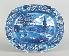 """Pook & Pook.  October 2nd 2010. Lot 479.  Estimated: $1K - $2K.   Realized Price: $2133.   Historical blue Staffordshire platter depicting the Mendenhall Ferry, 13 3/4"""" l., 16 3/4"""" w."""