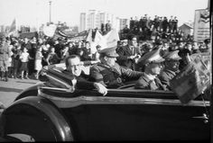 Juan Negrín, then Prime Minister of the Republic, visits Barcelona to farewell the International Brigades, 28th October, 1938. Robert Capa can be seen with a camera on the other side of the car.