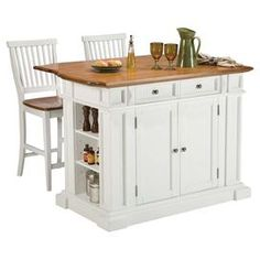 Kitchen island with a drop-down breakfast bar and two coordinating stools.  Product: Kitchen island and 2 barstoolsConstruction Material:  Dimensions: 36.5 H x 49.75 W x 36.5 D (island)