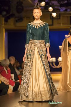 Gorgeos bottle green jacket lehenga with mirror work by Manish Malhotra at Shree Raj Mahal Jewellers India Couture Week 2014 #bmwibfw See the rest of the collection at http://thedelhibride.com/2014/08/06/manish-malhotra-india-couture-week-2014/