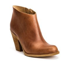 Dolce e piccante: the sweet ankle boot with a hint of edge. In washed, smooth, golden brown, matte vitello leather with a 3.25-inch stacked leather heel, narrow toe, leather zipper pull, and vero cuoio sole.