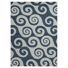 Hand-hooked indoor/outdoor rug with a swirling wave motif.    Product: RugConstruction Material: PolypropyleneColor: BlueFeatures:  DurableSuitable for indoor and outdoor useLooped Note: Please be aware that actual colors may vary from those shown on your screen. Accent rugs may also not show the entire pattern that the corresponding area rugs have.Cleaning and Care: Vacuum regularly and blot spills immediately. Deep or steam clean to relase dirt from fibers.