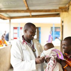 Medical staff working in busy African clinic.