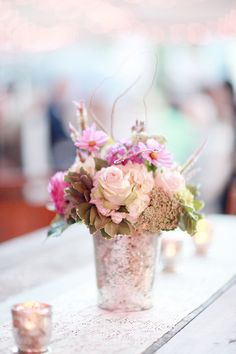 floral centerpiece in mercury glass, photo by Simply Bloom http://ruffledblog.com/romantic-alabama-wedding #centerpieces #mercuryglass