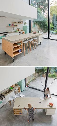 8 Examples Of Kitchens With Movable Islands That Make It Easy To Change The Layout Concrete, wood and white drawers make up this movable kitchen island design, keeping it consistent with the modern eclectic look of the rest of the kitchen. Mobile Kitchen Island, Portable Kitchen Island, Kitchen Island Bar, Modern Kitchen Island, Kitchen Island On Wheels With Seating, Movable Island Kitchen, Ikea Kitchen, Modern Kitchens, Kitchen Island Countertop Ideas