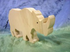 Rhinoceros wooden toy rhino by Dadswoodentoys on Etsy, $5.95
