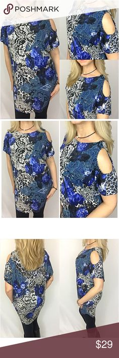 "Beautiful Cold Shoulder Tunic Dress SML Beautiful cold shoulder tunic dress in a royal blue, black & ivory floral print. Soft & stretchy with ample room in bust with dolman type cut in sleeve area. Wear alone or pair with leggings, favorite denim or capris.   Small Bust 50"" Waist 46"" Length 31"" Medium Bust 51"" Waist 47"" Length 32"" Large Bust 52"" Waist 48"" Length 33"" Tops"