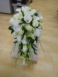 white calla and roses in a classic shower bouquet   www.weddingflowersbylaura.com