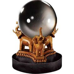 This divination crystal ball is a detailed recreation of the ones used by the students in Professor Sybill Telawney's Divination class.  This replica features a solid glass ball on a carved elephant base. Measures 5 inches in height.