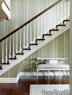 The entry's hand-blocked wallpaper is Claremont's Palm Stripe.