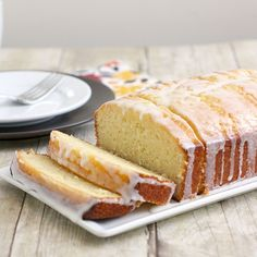 Lemon loaf soaked in lemon syrup and topped with a lemon glaze. Add poppy seeds to loaf