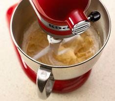 Fuel your culinary passion with the revolutionary KitchenAid Candy Apple Red Artisan® Design Series 5 Quart Tilt-Head Stand Mixer with Glass Bowl, product number