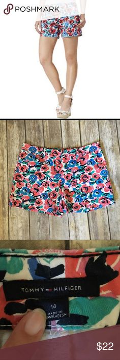 Tommy Hilfiger Twill Flower Shorts Flower Print twill shorts. Size 14 . In excellent used condition. 37 inch inseam. 5 inch inseam. 4 useable pockets. Shorts have button and clasps. 100% cotton Tommy Hilfiger Shorts