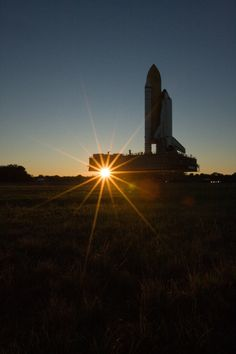 Shuttle Endeavour is silhouetted against the dawn sky as it rolls to Launch Pad 39A for STS-130 launch preparations.