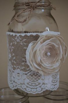 For sale is 10 handmade shabby chic mason jar sleeves. Perfect for a rustic wedding! Burlap adorned with lace and handmade light brown/Ivory #shabbychicweddingcenterpieces