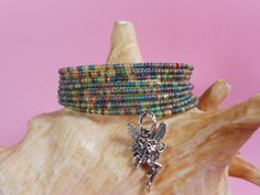 Rainforest and Fairy memory cuff, Boho jewelry, cuff bracelet, beaded cuff, 8 rows, silver Fairy charm, memory bracelet, wrap bracelet