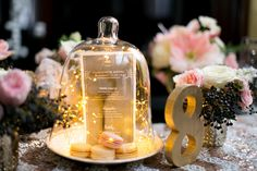 Twinkle lights under a bell jar | Caili Helsper and Tuan H. Bui Photography | see more on