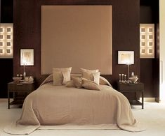 """""""The colors are neutral and the lines soft yet in keeping with the theme of visual symmetry,"""" Hoppen says of the master bedroom. Two back-lighted plaster-and-papier-mâché wall fixtures and two Robert Besanko photographs flank the bed. The headboard is covered in alpaca."""