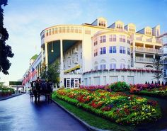 Grand Hotel - Mackinaw Island, Mich - This hotel, built in the late 19th century, is known to have more than a few haunts as a result of some grisly historic facts. It is said that when the hotel's foundation was laid, many human skeletons were unearthed. And the small horse corral is said to be on the site of the first post cemetery. Rumor has it that not all the bodies were recovered when the cemetery was moved to its new location.