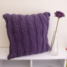 http://www.etsy.com/listing/76898437/cushion-cover-knitted-with-cables-purple