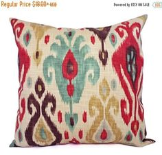 This listing is for two ikat couch pillow covers in a red and brown ikat print with spa blue accents. These modern decorative pillow covers would be a great addition to your living room! The ikat cushion covers fit pillow inserts sized from a 12 x 16 lumbar pillow insert to a 26 x 26 euro sham and are 55% Linen and 45% Rayon.  *****This listing is for just the pillow covers, the inserts are not included.*****  The fabric is the same on both the front and back of the pillow covers. The exact…