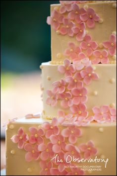 Pink floral on cake! This is very easy to do with the right tips! All you would need is a flower tip to make these and then the yellow dot centers are made just with the writing tip! :) Easy and yet looks like you took a lot of time on this cake.
