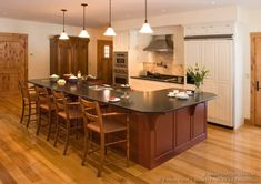 Idea of the Day: Two-Tone Kitchens in Traditional Homes - Gallery. (By Crown Point Cabinetry). Very good, two tone white red island seats wood floor pendant Kitchen Lighting Design, Kitchen Lighting Fixtures, Kitchen Design, Crown Point Cabinetry, Two Tone Kitchen Cabinets, Island With Seating, Home Upgrades, Kitchen Pictures, Traditional House