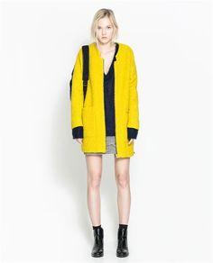 Желтое пальто в клетку