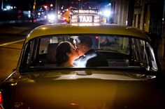 A New York City wedding isn't complete without a shot in a vintage yellow taxi. Love this shot.