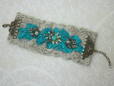 Turquoise Lace Cuff by MagicalMysteryTuca on Etsy