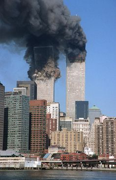 In this Tuesday, Sept. 2001 file photo, the south tower starts to collapse as smoke billows from both buildings of the World Trade Center in New York. World Trade Towers, World Trade Center Nyc, World Trade Center Attack, Trade Centre, 11 September 2001, Remembering September 11th, Remembering 911, Ville New York, Then And Now Photos