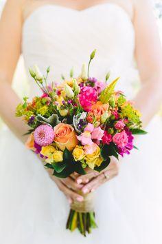 bright wedding bouquet http://www.weddingchicks.com/2013/10/22/colorful-cape-cod-wedding/