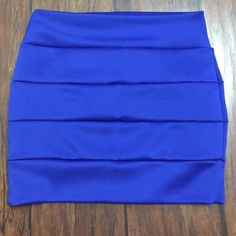 A'Gaci Mini Skirt Look insanely hot with this mean mini skirt! Banded body. Finished edges. Style with a cropped top and pointy pumps for a party-ready outfit! Worn only once as part of my Halloween party costume. a'gaci Skirts Mini