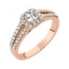Precious-timanttisormus, Malmin Korupaja. Kaunis punakultainen Precious-timanttisormus halo-istutuksella. Näyttävä Precious -sormus on tyylitietoisen naisen valinta. Upeaa sormusta koristaa yksi isompi, radiant-hiottu timantti (1 x 0,41ct) sekä sen ympärillä ja sivuilla kahdessa rivissä pienempiä timantteja (38 x n. 0,011ct). www.korupaja.fi