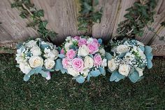 Summer wedding bouquet with a pink theme. White and pink roses with greenery.
